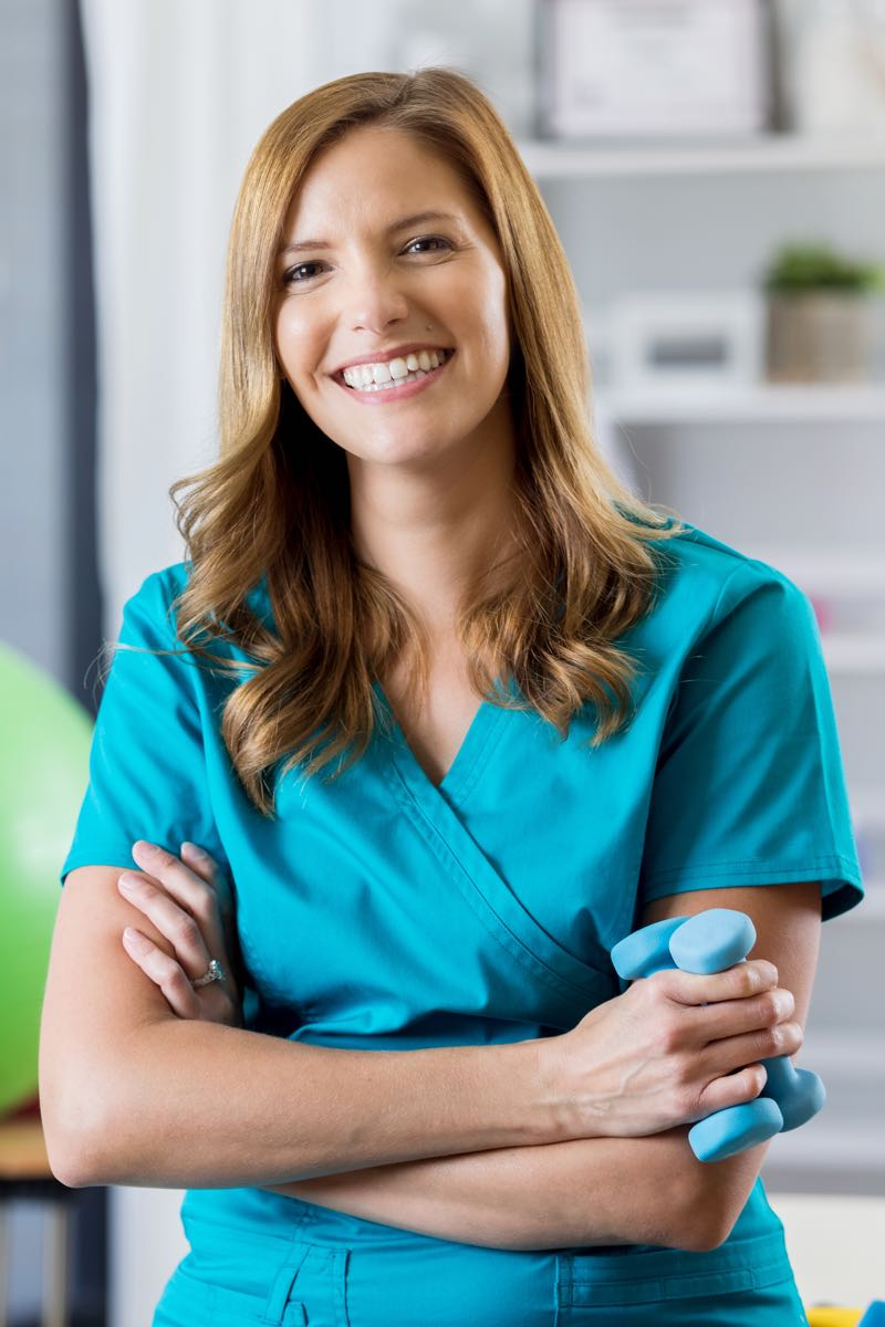 Female physical therapist assistant smiling