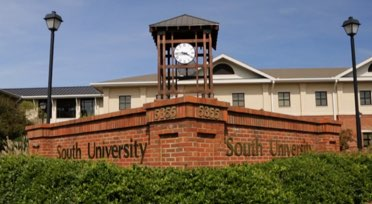 South University sign with clock tower