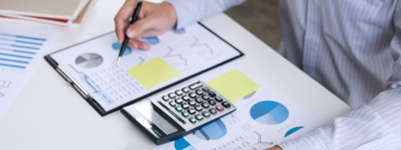 Accountant looking over graph on desk